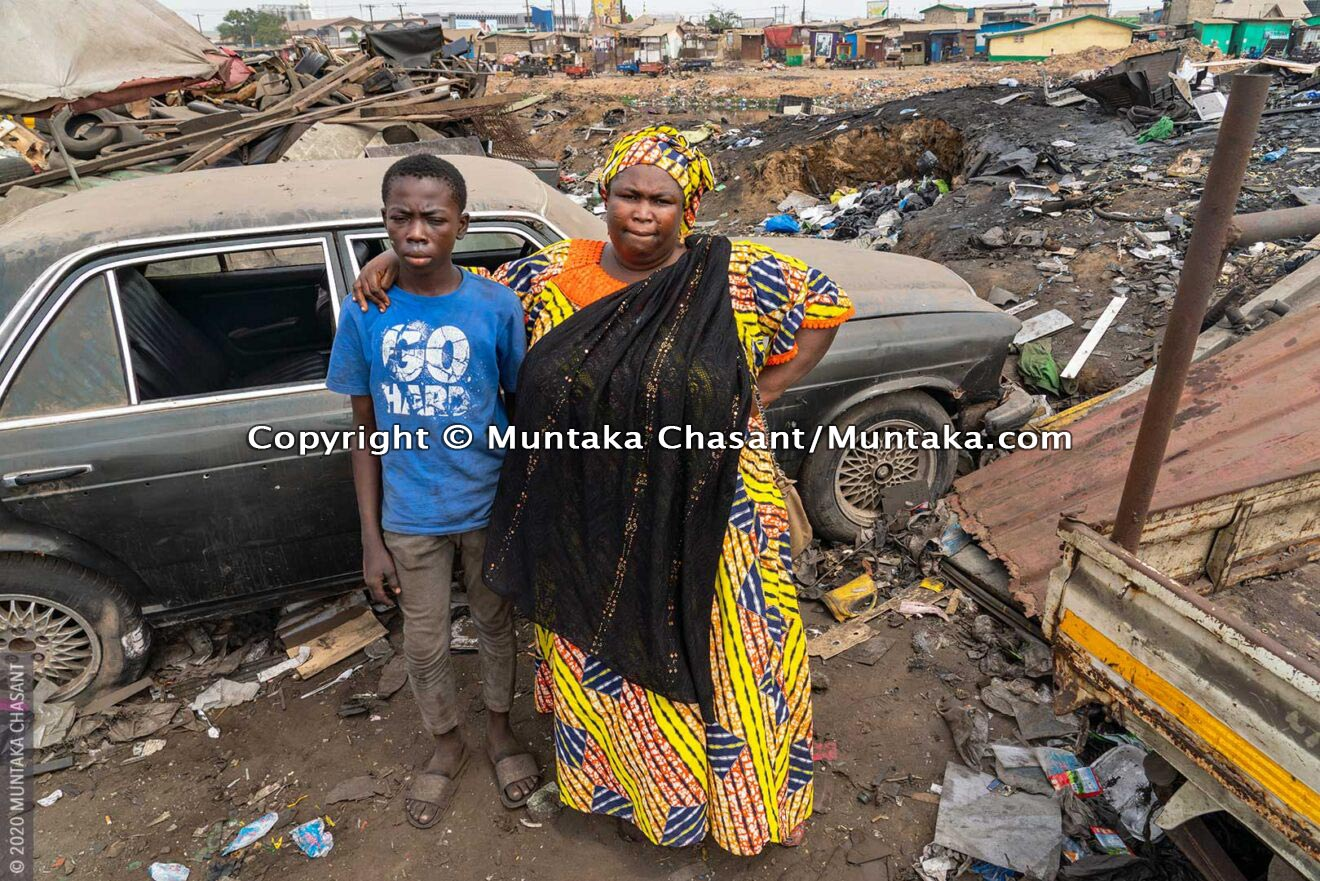 Malik, 14 years, reuniting with his aunt, Wasila, inside the Agbogbloshie scrapyard in Accra Ghana. Malik had lived in Agbogbloshie from August 2019 until February 19, 2020. © 2020 Muntaka Chasant