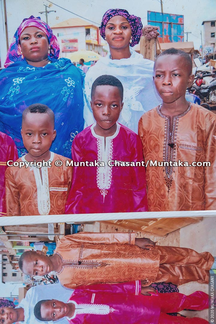 Malik (far right) in a 2015 family portrait. Wasila showed me their family album to throw some light on Malik's past. February 19, 2020. © 2020 Muntaka Chasant