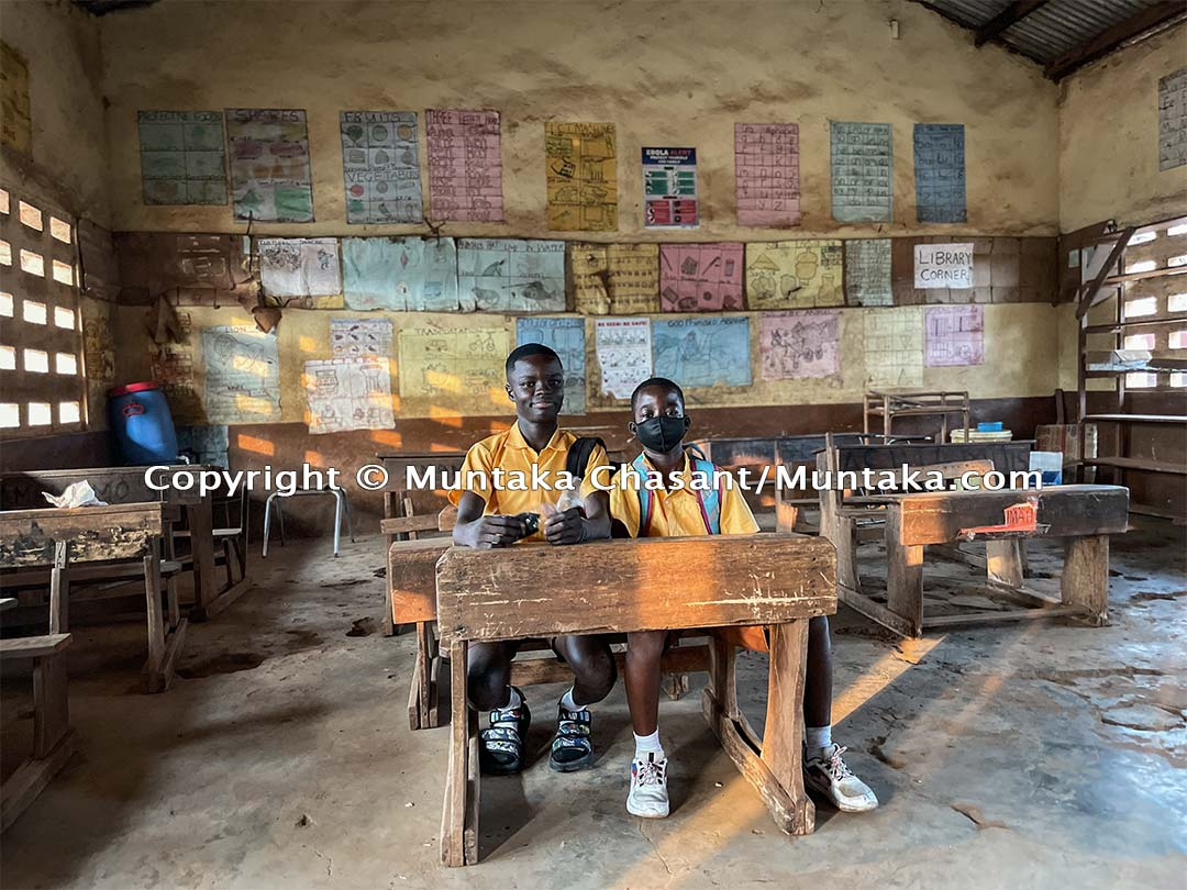 Youth poverty in Ghana: Kingsford (left) and Natus (right) on their first day at the Ashia Mills Basic Schools in Accra, Ghana. Both were placed in class 3 (grade 3). Both Kingsford and Natus are engaged in hazardous child labour around Agbogbloshie. Copyright © 2021 Muntaka Chasant