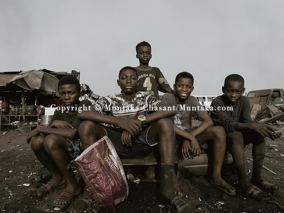 Young people engaged in hazardous child labour, Agbogbloshie, Ghana. Shot with an iPhone. Copyright © 2021 Muntaka Chasant