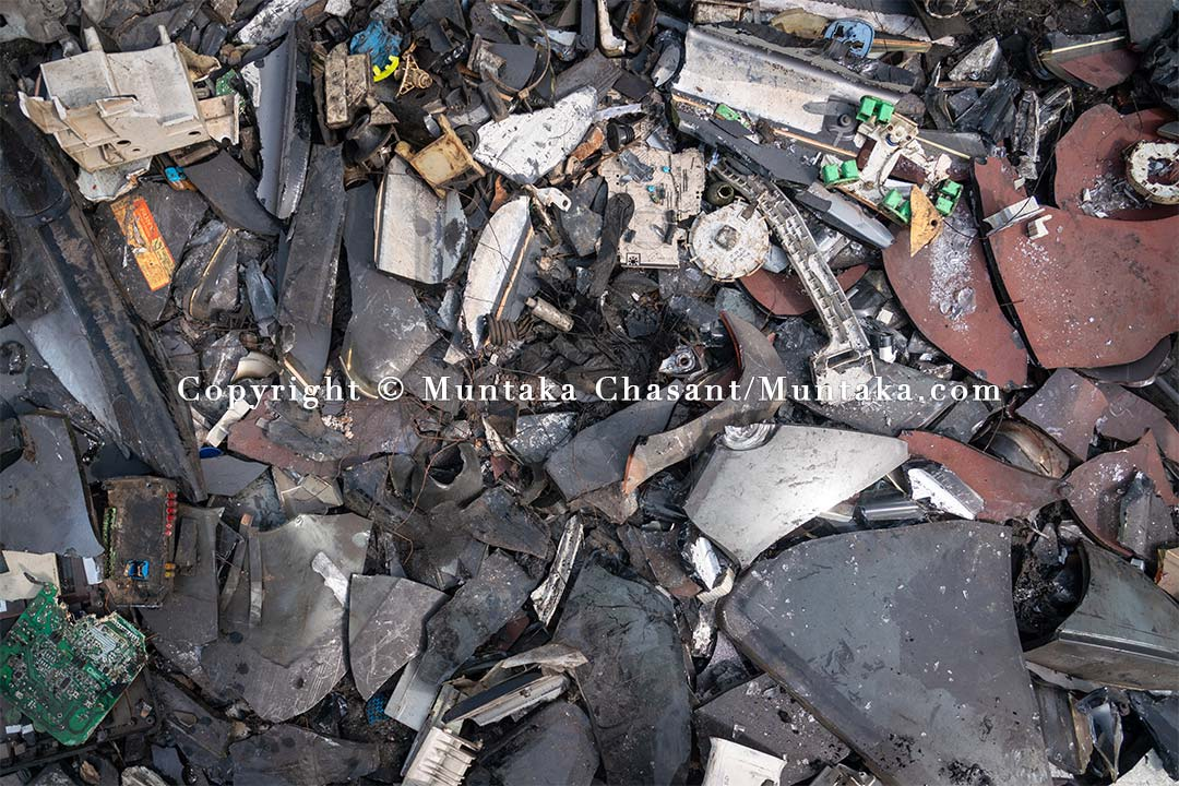 An e-waste dumpsite covered with broken CRT TV glass, Agbogbloshie, Ghana. Copyright © 2021 Muntaka Chasant