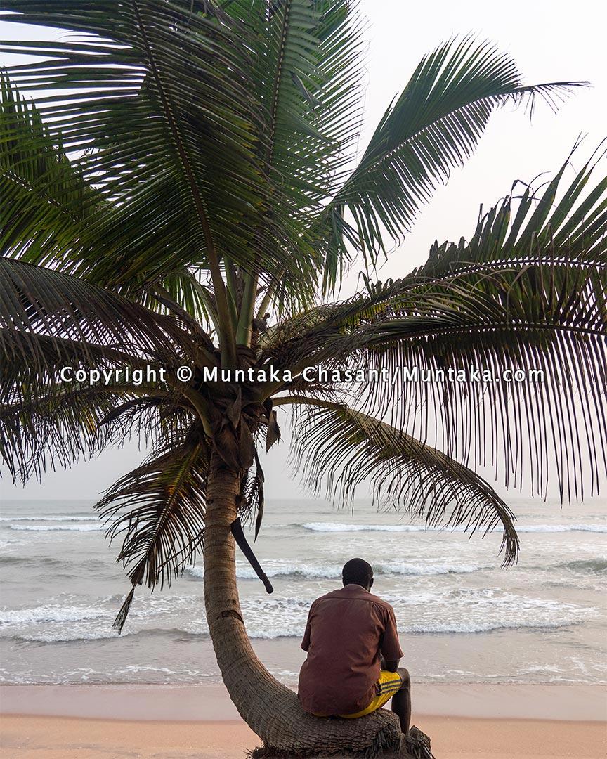 Fisherman rests at the beach. Copyright © 2021 Muntaka Chasant