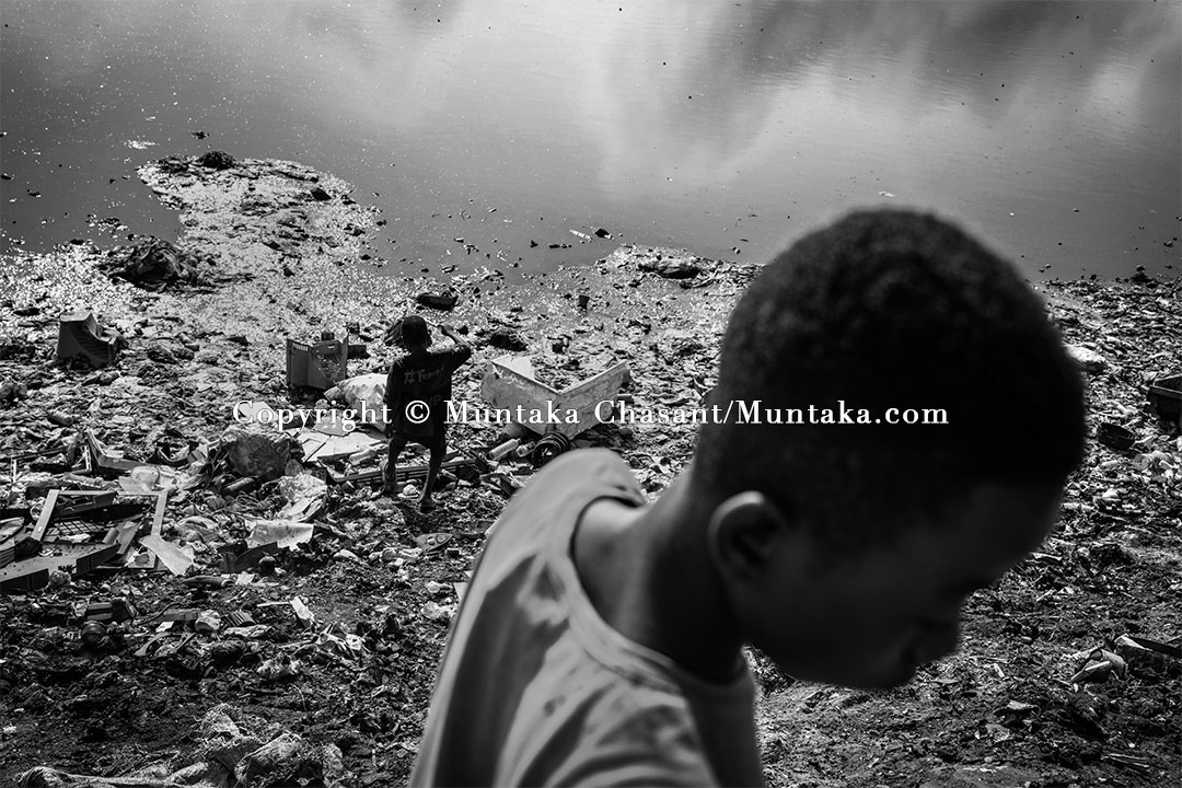 Child labourers on the banks of the Korle Lagoon, Accra, Ghana. Copyright © Muntaka Chasant
