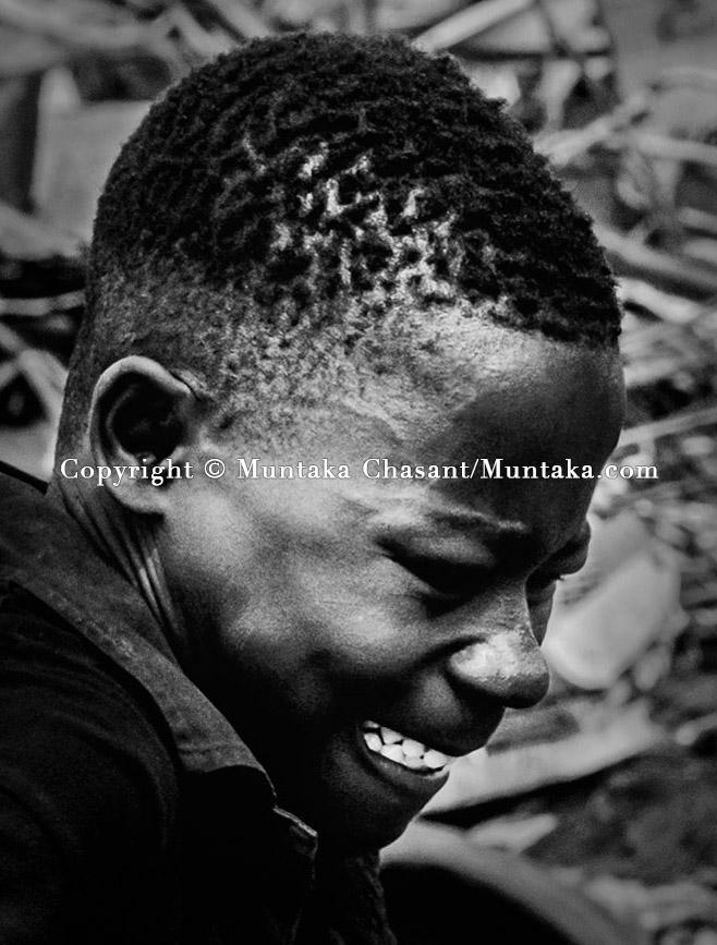 Portrait of an adolescent boy engaged in hazardous child labour by the Korle Lagoon. Copyright © Muntaka Chasant