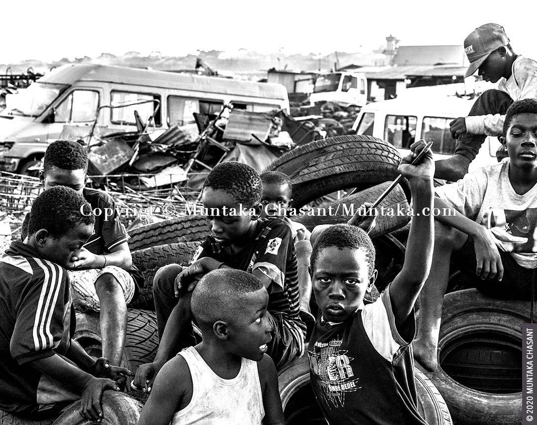 Children engaged in hazardous child labour hang out on an e-waste dump at Agbogbloshie, Ghana. Around 73 million children between 5 and 17 years worldwide are in hazardous child labour, ILO statistics show. © 2020 Muntaka Chasant