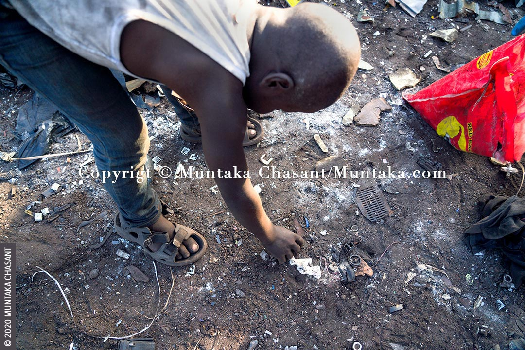 Hazardous child labour at Agbogbloshie: An 8-year-old boy engaged in hazardous child labour handpick pieces of metals deposited in the soil at Agbogbloshie, Ghana. He sold the metals at around GH₵0.80 ($0.15) per kilo at Agbogbloshie. This exposed him to lead, cadmium, arsenic, and other heavy metals. © 2020 Muntaka Chasant