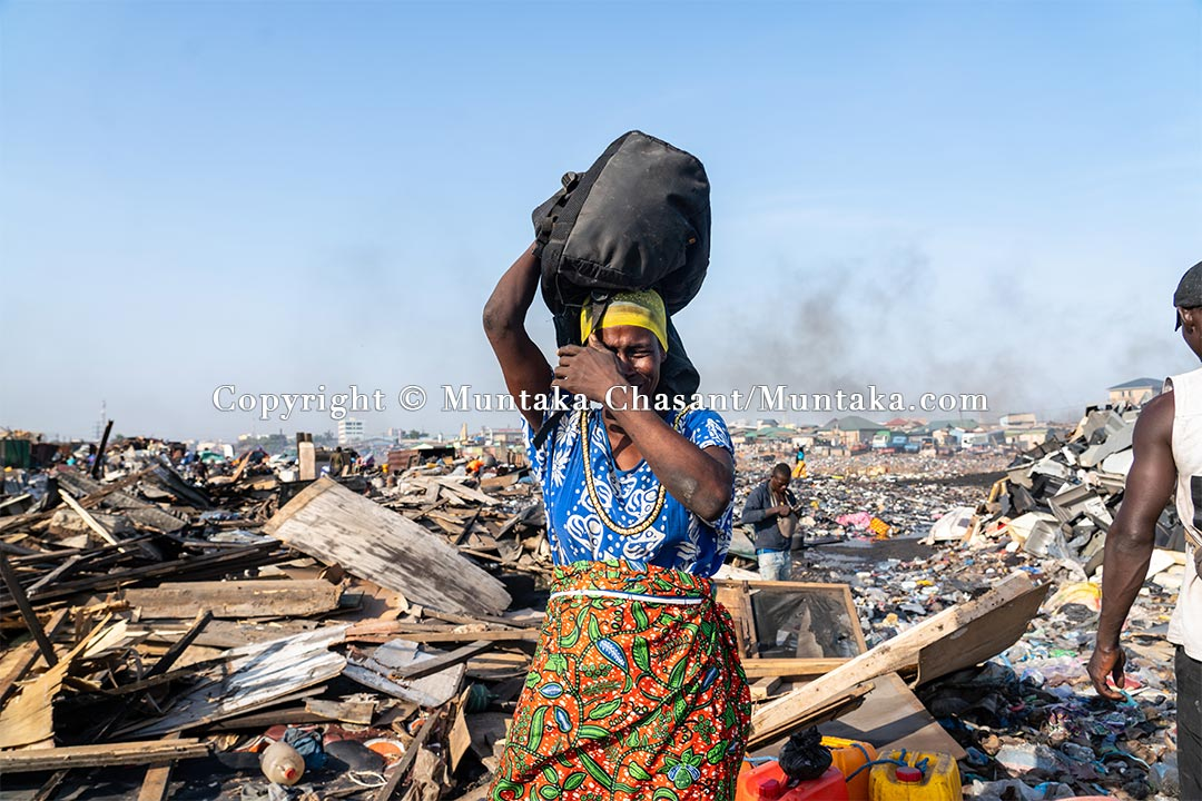 A displaced woman cries after the demolition of the Agbogbloshie Scrapyard on July 1, 2021. Copyright © Muntaka Chasant