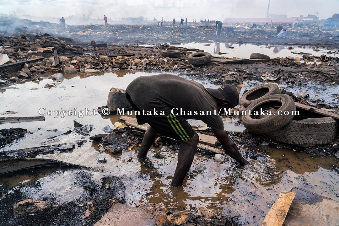 Kwasi, 36 years old, scavenges from the demolished Agbogbloshie ruin. Copyright © Muntaka Chasant