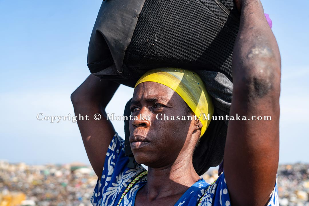 A woman is displaced after the Agbogbloshie demolition. Copyright © Muntaka Chasant
