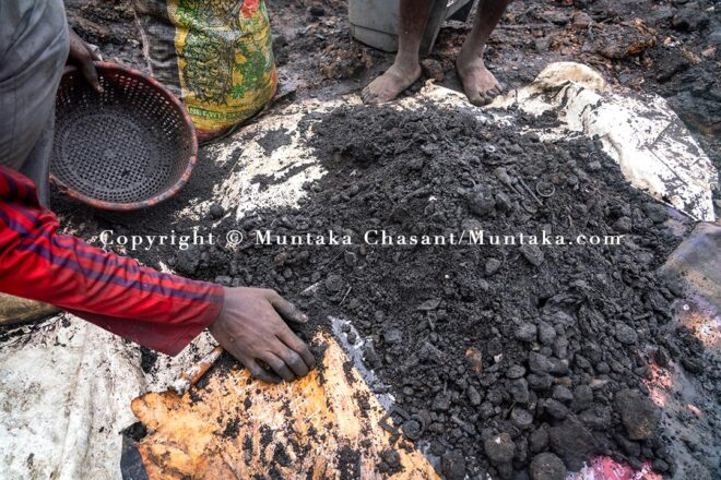 Processing to separate dirt from rusted scrap metal recovered after digging deep into the surface of the demolished Agbogbloshie site. Copyright © Muntaka Chasant