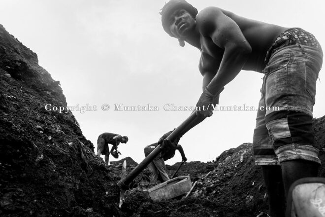 September 14, 2021: Urban poor men search for scrap metal buried deep under the surface of the demolished Agbogbloshie Scrapyard site. Copyright © Muntaka Chasant